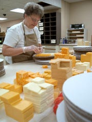 Irene Smits at Dairy State Cheese in Rudolph prepares