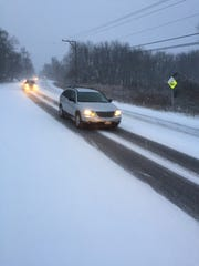Motorists dive along a snow covered Route 9 in Philipstown on Friday morning.