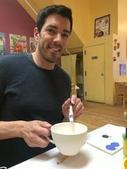 Drew Scott at a store that offered an evening of pottery