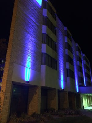 Blue uplights were installed at Hotel Mead on Sept. 14 to enhance the downtown area.