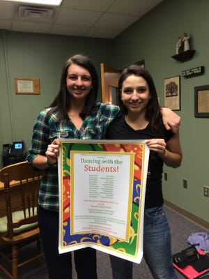 "Nekoosa High School students Elizabeth Henricksen and Bridget Hofmeister pose with a poster promoting the April 11 ""Dancing with the Students"" event."