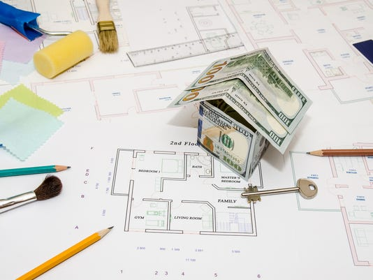 architectural drawings for houses with dollar, paints, brushes and accessories