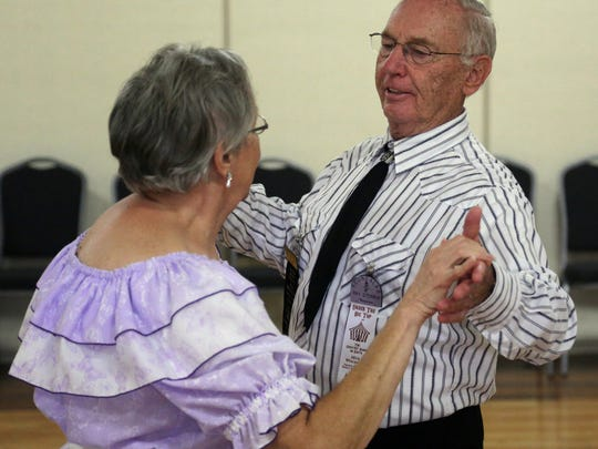Ray and Marilyn Steinich of Pardeeville do some round dancing Sunday, Aug. 10, 2014, at the Central Wisconsin Convention & Expo Center in Rothschild.