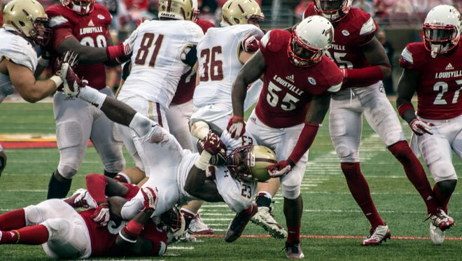 Boston College RB Myles Willis gets taken down by UofL's James Burgess and Keith Kelsey in the fourth quarter. 10/24/15
