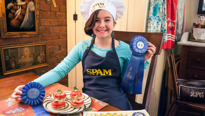 Magnolia Suddeth shows off the awards her SPAM Hot Brown won at the 2015 Kentucky State Fair and SPAM National competition. 2/10/16