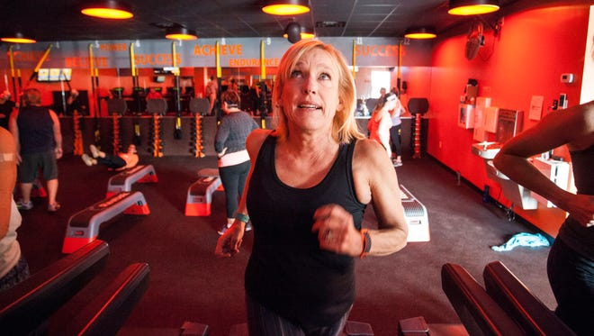 Kirby Adams watches her heart rate in real time on a monitor at Orange Theory in St. Matthews. 2/19/16