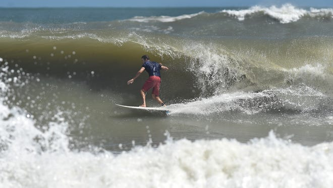 """James Loehr, of Fort Pierce, rides in the tube of rough waves as swells from Hurricane Maria kick up the surf at Fort Pierce Inlet State Park on Monday, Sept. 25, in Fort Pierce. """" """"It's been messy, the northeast winds, I think tomorrow its supposed to get better, (winds) to be offshore from the southwest, I think tomorrow will be the day,"""" Loehr said. """"It's good out there, better than it was in July."""""""