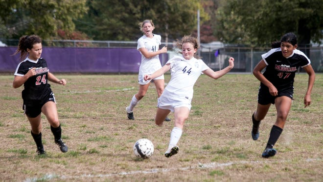 Sacred Heart's Brielle Heuglin hurries the ball past Manual defenders during the 7th Region Soccer Final. 10/21/17