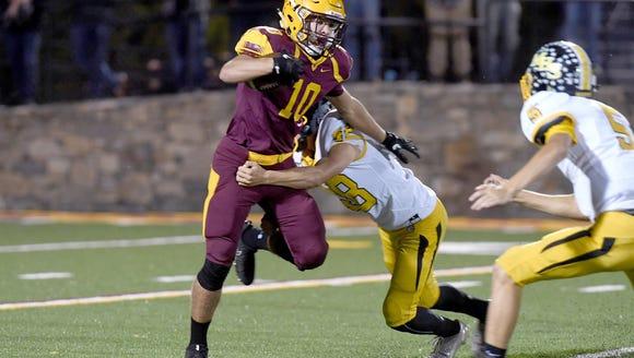 Cherokee's Cade Mintz runs the ball as Murphy's Kyle
