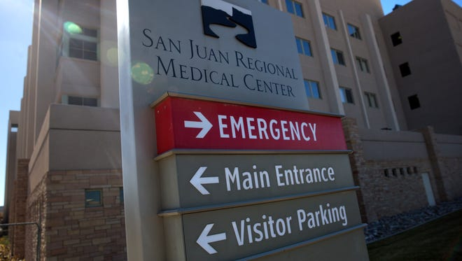 A sign directs visitors to the emergency room at the San Juan Regional Medical Center in Farmington.