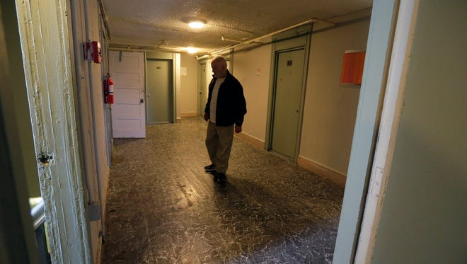 Musa Guleen, property manager, talks about the flooring during a tour of the Delmonte Hotel in Asbury Park, an old boarding house that's been a safety and crime concern for many years, in Asbury Park, NJ Tuesday February 27, 2018.