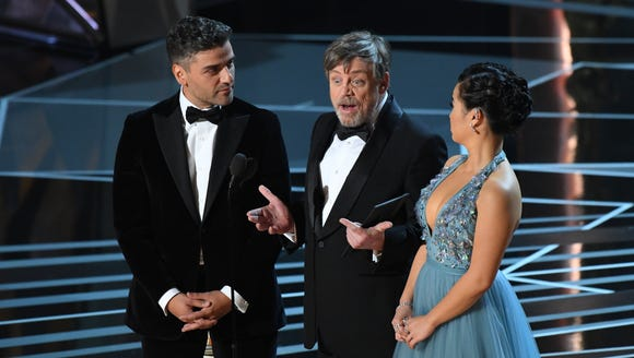 Mark Hamill (center) presented at the Oscars alongside
