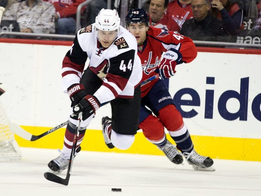 Washington Capitals right wing Tom Wilson, right, chases after Arizona Coyotes defenseman Kevin Connauton during the first period of an NHL hockey game, on Monday, Feb. 22, 2016, in Washington. (AP Photo/Evan Vucci)