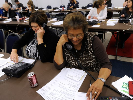 Volunteers Colleen Rud (left) and Vicky Potts, both from Elliott-Hamil Funeral Home, work the phones during the West Texas Rehabilitation Center's Rehab Phonathon on Wednesday, Jan. 18, 2017, at the Abilene Convention Center. The effort will continue tonight ahead of Saturday's telethon.