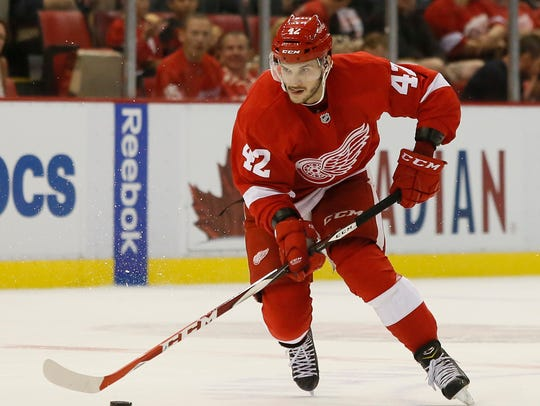 Martin Frk drives down the ice for the Red Wings against