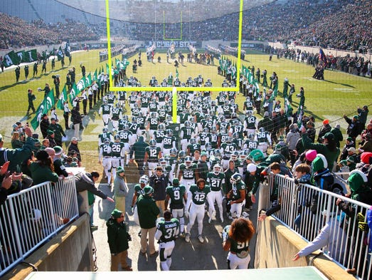 Michigan State players enter the field prior to a game on Nov. 30, 2013, at Spartan Stadium.