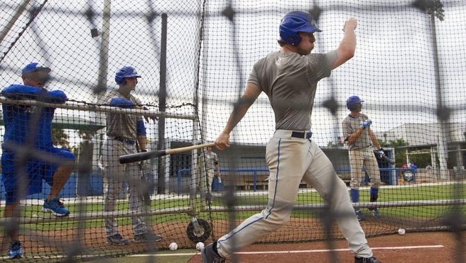 Michael Suchy hits during FGCU baseball practice on Wednesday, Feb 12.