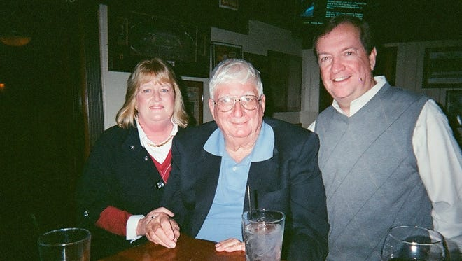 """Richard """"Moon"""" Mullins (center), former ASU sports information director and a member of the ASU athletic Hall of Distinction, died at age 84."""