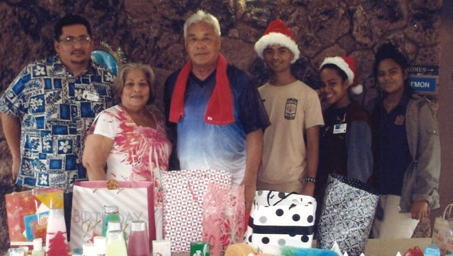 George Washington High School students in Tina Flores's art class donated toiletries and gifts for the residents of Guma Tranklidat in Tumon. Pictured: Patrick Bamba, resident manager, Mrs. Millar, Frank Santos, volunteers, Ander Weito, J-Liz Inocenti and Rimiann Tataichy, GWHS students.