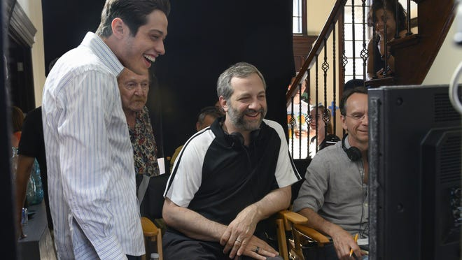 Pete Davidson, left, looks on as Judd Apatow checks out a scene from their new film.