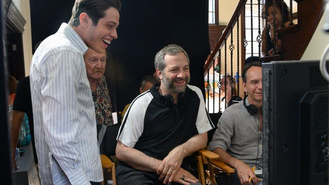 Pete Davidson (left) looks on as Judd Apatow checks out a scene from their new film.