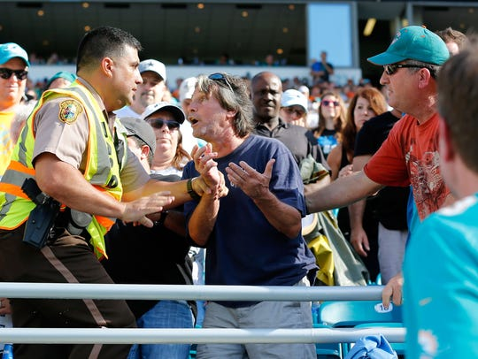 A fan gets arrested by Miami Dade police officer in