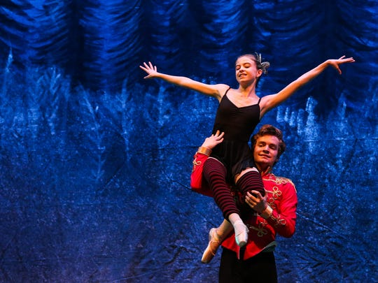"Michael Sherrod as Nutcracker Prince and Nico Covington as Young Clara dance in the snow scene during ""The Nutcracker"" rehearsal Tuesday, Dec. 12, at Murphey Performance Hall."