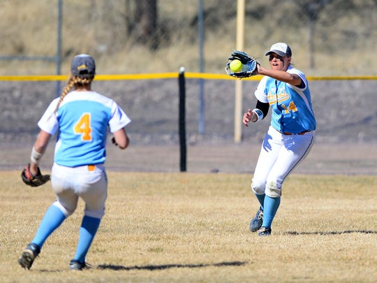 Alex Lowry, right, pictured playing for the University of Great Falls in 2016, has been hired as the new softball coach at CMR.