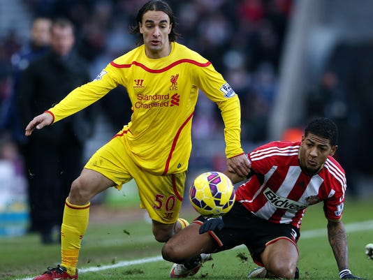 Liverpool's Lazar Markovic, left, vies for the ball with Sunderland's Patrick Van Aanholt, right, during their English Premier League soccer match at the Stadium of Light, Sunderland, England, Saturday, Jan. 10, 2015. (AP Photo/Scott Heppell)