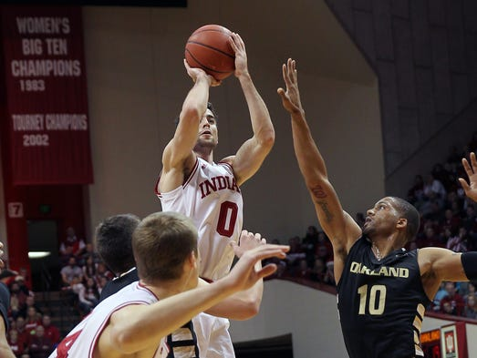Indiana Hoosiers forward Will Sheehey (0) shoots over Oakland Golden Grizzlies guard Duke Mondy (10) during the first half at Assembly Hall. Indiana won 81-54. Mandatory Credit: Pat Lovell-USA TODAY Sports