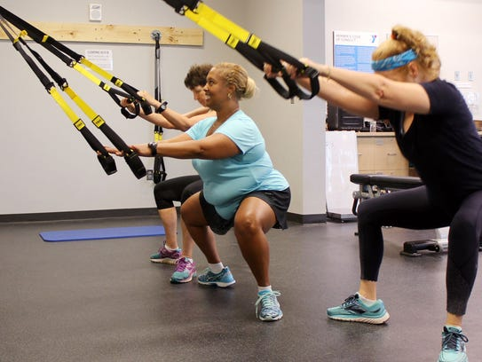 Fitness instructor Sharon Jones (center) lost 125 lbs.