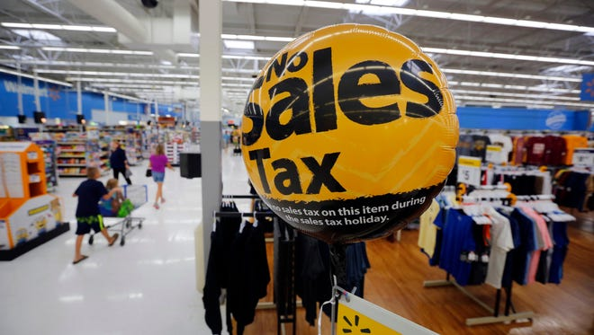 Signs and balloons remind shoppers of the sales tax holiday this Friday and Saturday.
