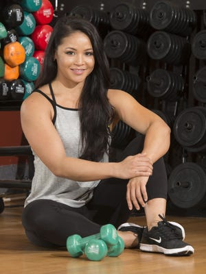 Heidi Jo Medina poses before her workout at Pensacola Fitness on North Ninth Avenue.