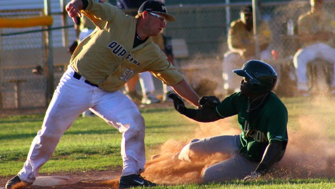 White Sands third baseman TJ Wharton tags out a Tucson Saguaros base-runner Tuesday evening at the Griggs Sports Complex.