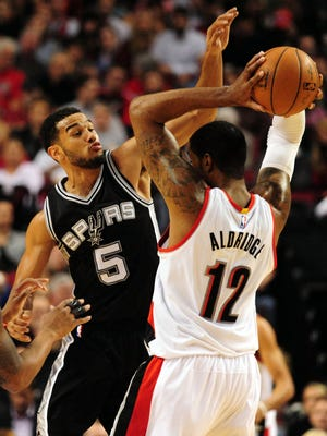 San Antonio Spurs guard Cory Joseph (5) pressures Portland Trail Blazers forward LaMarcus Aldridge (12)  during the third quarter of the game at the Moda Center at the Rose Quarter.