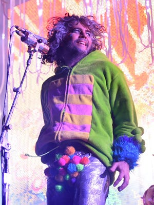 Frontman Wayne Coyne of The Flaming Lips performs during the Life is Beautiful festival on October 25, 2014, in Las Vegas.
