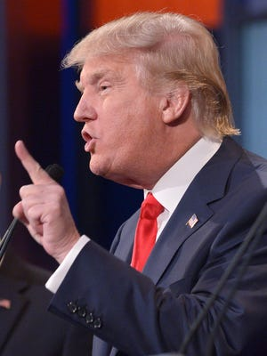 Real estate tycoon Donald Trump speaks during the prime time Republican presidential debate in this August 6, 2015, file photo at the Quicken Loans Arena in Cleveland, Ohio.