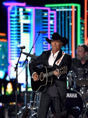 Honoree George Strait performs during the 50th Academy of Country Music Awards at AT&T Stadium on April 19, 2015 in Arlington, Texas.