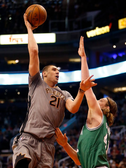 Phoenix Suns center Alex Len, left, shoots over Boston Celtics center Kelly Olynyk, right, in the second quarter during an NBA basketball game, Saturday, March 26, 2016, in Phoenix. (AP Photo/Rick Scuteri)