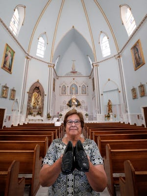The cloistered Sisters of Perpetual Adoration volunteer Norma Talamantes wants your gently worn shoes as the monastery tries to raise enough money for a sign for the building.