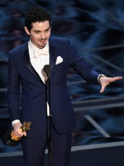 Damien Chazelle accepts the award for best director for 'La La Land.'