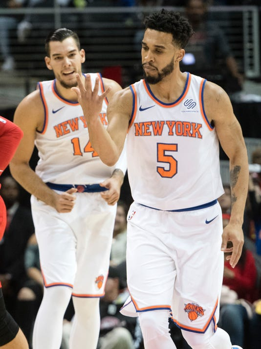 New York Knicks guard Courtney Lee (5) reacts after sinking a three pointer during the first half of a NBA basketball game against the Atlanta Hawks, Friday, Nov. 24, 2017, in Atlanta. (AP Photo/John Amis)