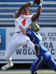 Bishop Gorman's Cedric Tillman goes up for a reception