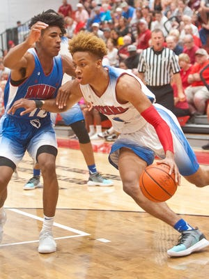 Indiana Senior All-Star Romeo Langford of New Albany H.S. (headed to Indiana) comes around Indiana Junior All Star Armaan Franklin of Cathedral H.S.