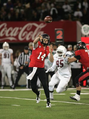 Ball State's Jack Milas throws during an NCAA college football game against Massachusetts, in Amherst, Mass., Wednesday, Nov. 12, 2014.