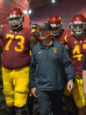 Southern California Trojans coach Steve Sarkisian leads players onto the field before the game against Washington.