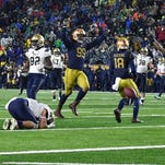 Notre Dame defense fights fatigue, makes huge fourth down stop to preserve win over Navy