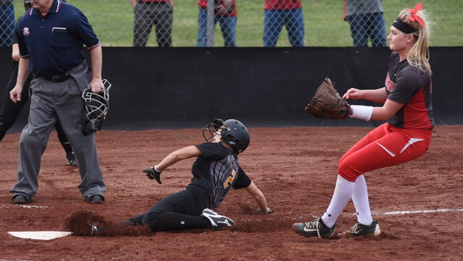 Tri-Valley's Alex Lemley slides home safely in front of Sheridan's Liv Johnson Monday night at Kenny Wolford Park.