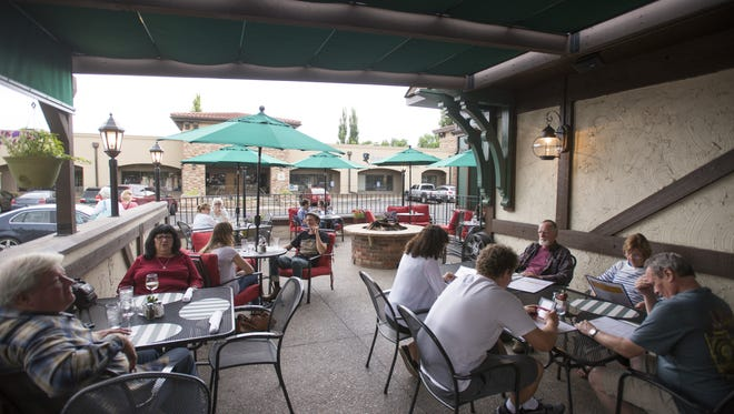 The Moot House serves up pub style dining in a large outdoor seating area at 2626 S. College Ave.