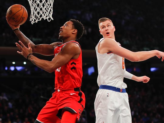 Toronto Raptors guard DeMar DeRozan (10) puts up a shot against New York Knicks forward Kristaps Porzingis (6) during the first quarter of an NBA basketball game, Wednesday, Nov. 22, 2017, in New York.